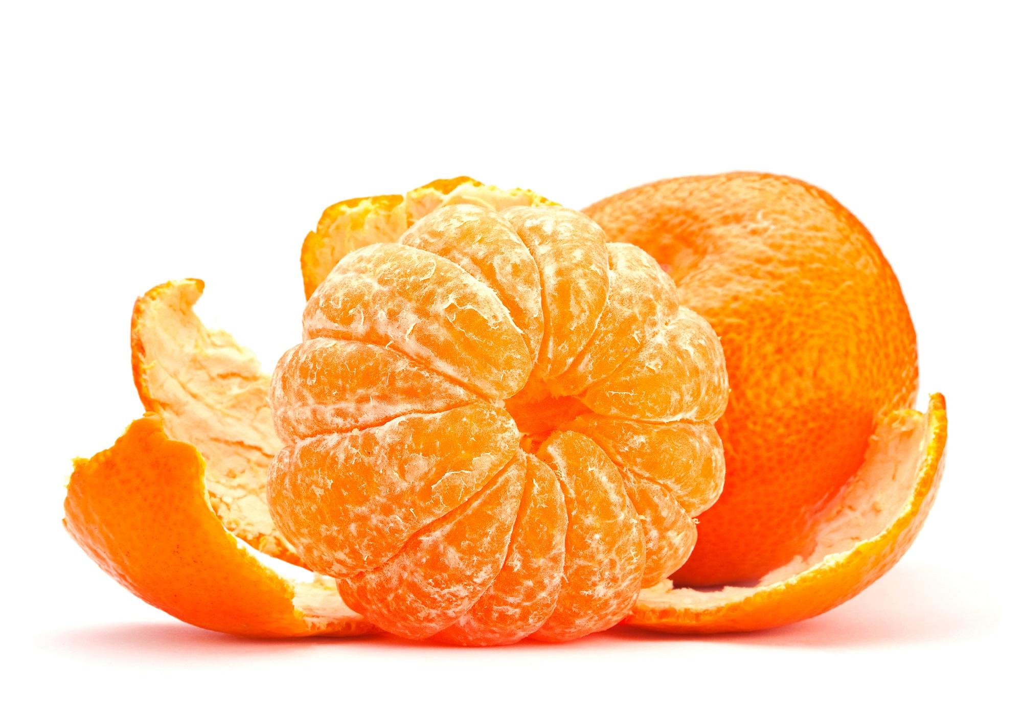 Open tangerine fruit isolated on white