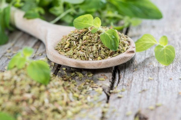 Wooden Spoon with shredded Oregano